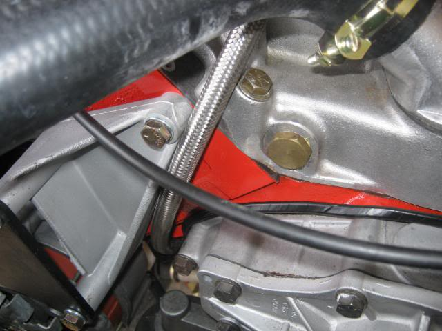 the b+ & alternator charge wires are originaly secured to the chassis rail  just rear of the battery tray by the same type of plastic clip that holds  the
